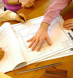 Gilday Renovations Architect discuss plans with clients