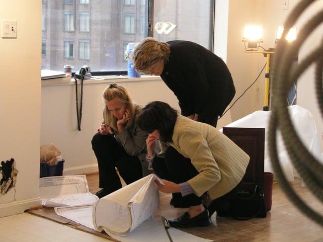 design build collaboration designers & client review renovation plans