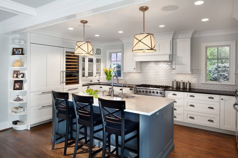 WHITE KITCHEN WITH GRAY ISLAND CABINETS BY GILDAY RENOVATIONS