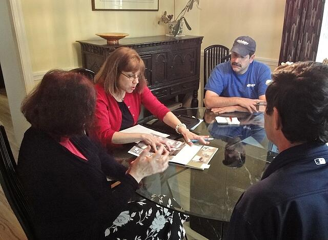 designer and carpenter meet with client for design build bath remodeling project