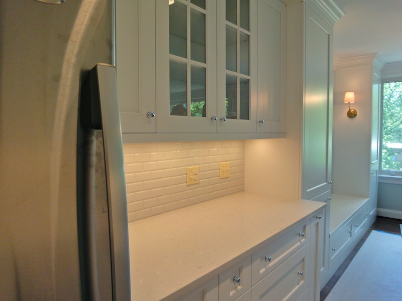 tiny condo kitchen is open to dining area