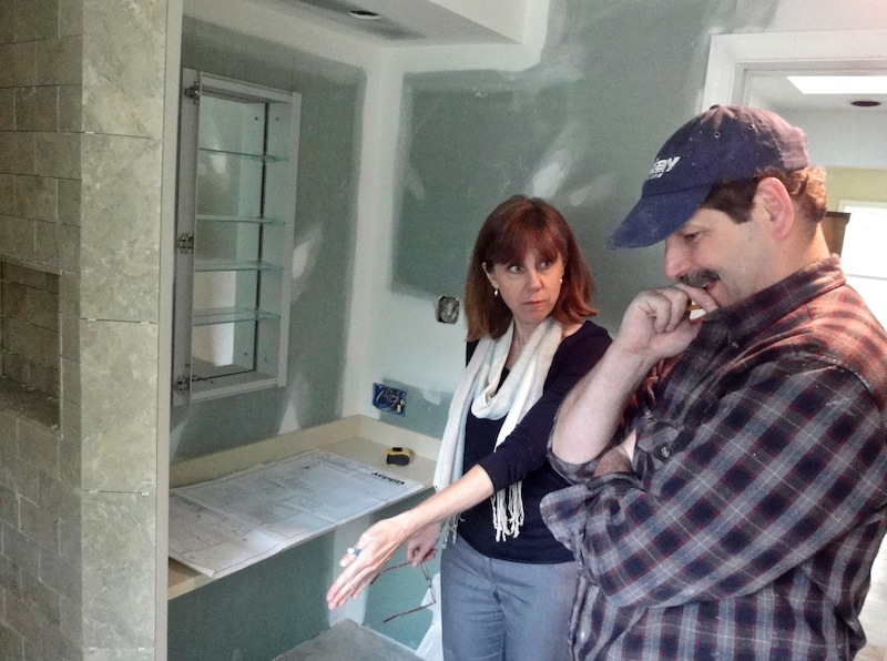 interior designer and carpenter cooperate in design build approach to bathroom remodeling
