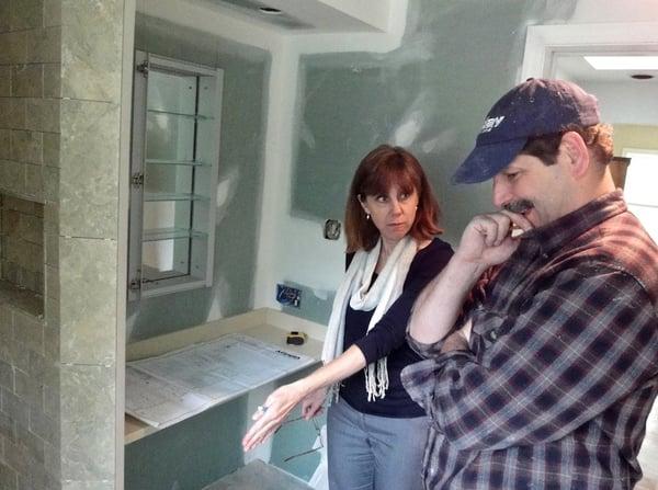 interior designer and carpenter cooperate in design build approach to bathroom remodeling