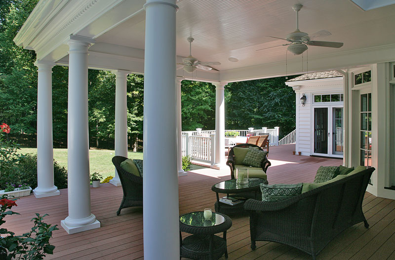 open style backyard porch with classic white columns