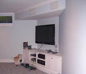 basement media center with built-in wall speakers