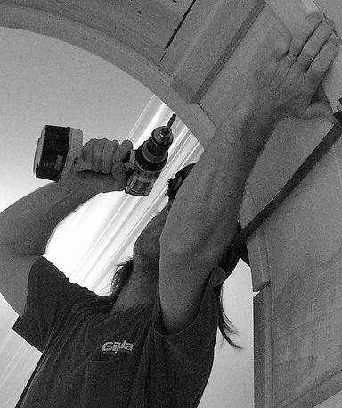 Gilday Renovations carpenter applies door trim