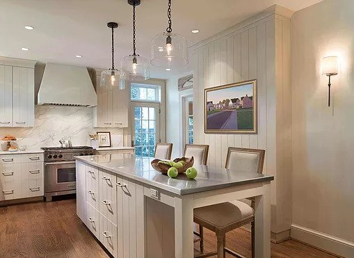Linen White Kitchen with vertically grovved cabinets